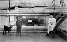 Children and pet goat aboard ship